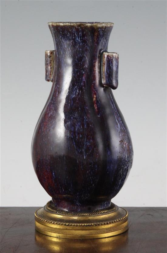 A Chinese flambe-glazed arrow vase, 18th/19th century, total height 21.7cm, faults