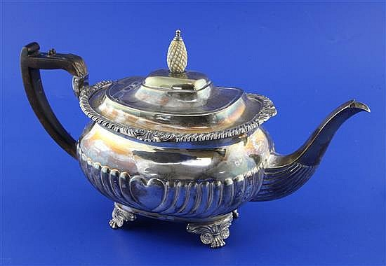 A late Victorian demi-fluted silver teapot, gross 22 oz.
