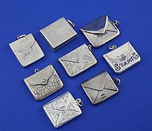 A collection of eight late Victorian and later silver stamp cases, 1.25in et infra.