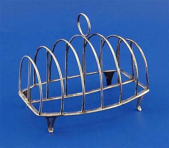A George III silver seven bar toast rack by William Abdy II, 4.5 oz.