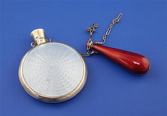 A late 19th/early 20th century Viennese silver and blue guilloche enamel moon shaped scent flask, 1.5in.