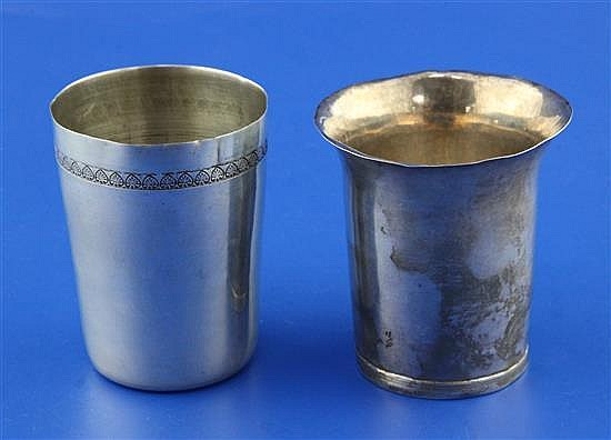 An late 18th century continental unmarked silver beaker and an early 20th century Egyptian silver beaker, 6.5 oz.