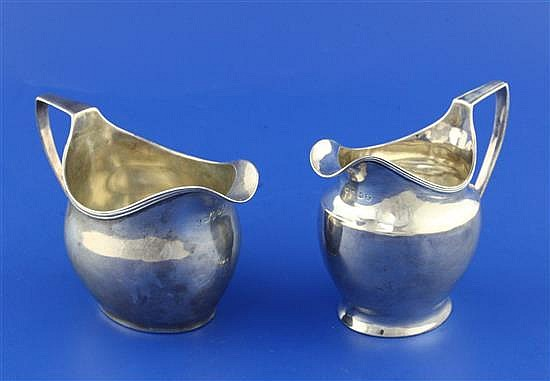 Two George III silver helmet shaped cream jugs, 6 oz.