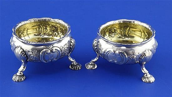 A pair of late George II silver bun salts by David Hennell I, 8.5 oz.