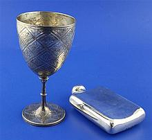 A Victorian engraved silver goblet and a hip flask, 13.5 oz.