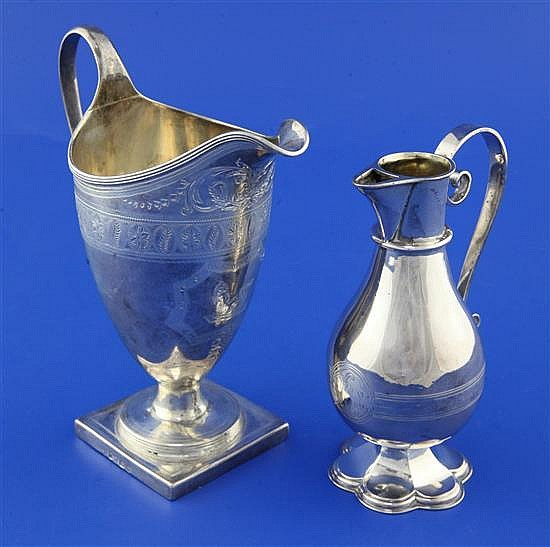 A George III silver helmet shaped cream jug by Alexander Field & later communion jug.
