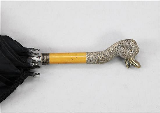 A late Victorian parasol with silver handle modelled as the head of a duck, handle overall 6in.