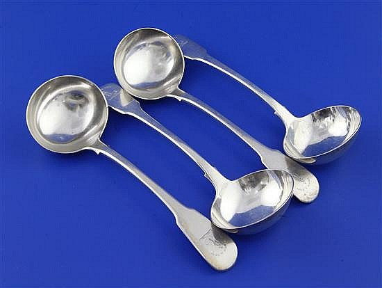 A set of four George III silver fiddle pattern sauce ladles by William Chawner II, 8 oz.