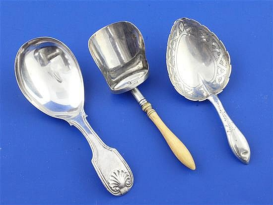A George III ivory handled silver shovel shaped caddy spoon,