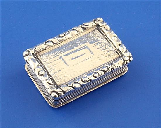 A George IV engine turned silver rectangular vinaigrette by Nathaniel Mills, 1in.