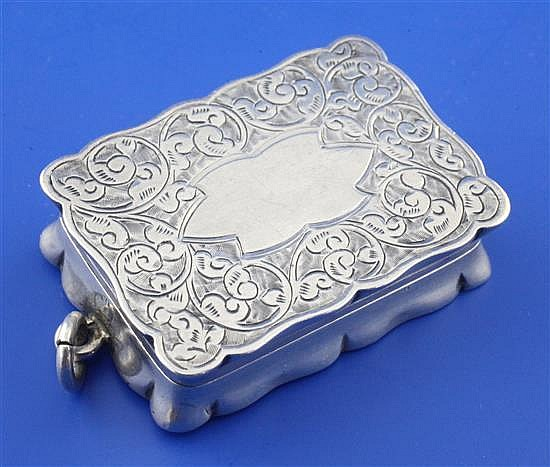 A late Victorian silver vinaigrette by Saunders & Shepherd, 1.75in.