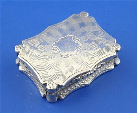 An early Victorian silver vinaigrette by Nathaniel Mills, 1.5in.
