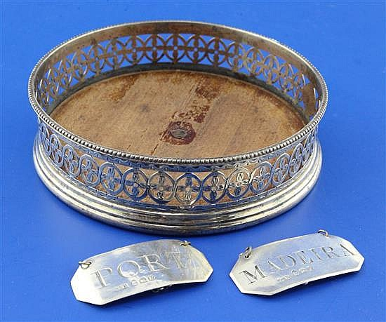 A George III pierced silver wine coaster by Robert Hennell I and pair of wine labels.