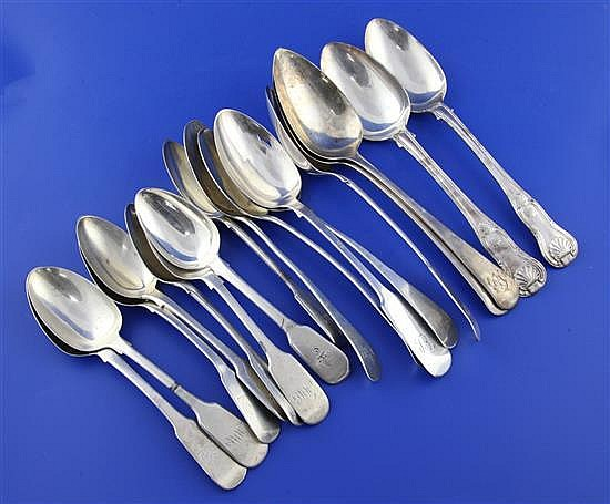 Nine assorted 19th century silver table spoons and eight silver dessert spoons, 30.5 oz.
