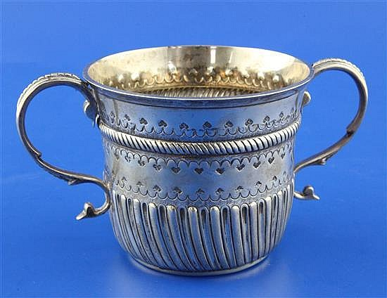 A George V early 18th century style repousse silver porringer, 8 oz.