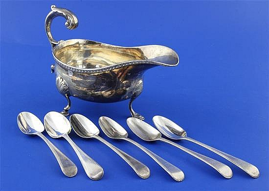 A George IV provincial silver sauceboat and 6 teaspooons, gross 9.5 oz.