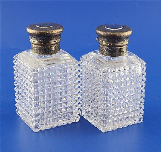 A pair of Victorian silver mounted hobnail cut glass scent bottles, 5.5in.