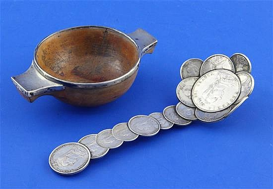 An early 19th century Scottish silver mounted blonde wood quaich and a spoon constructed with coins, 5.5in.