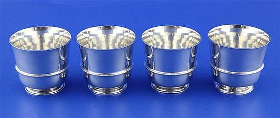 A set of four 20th century American? sterling silver tumbler cups, 15 oz.
