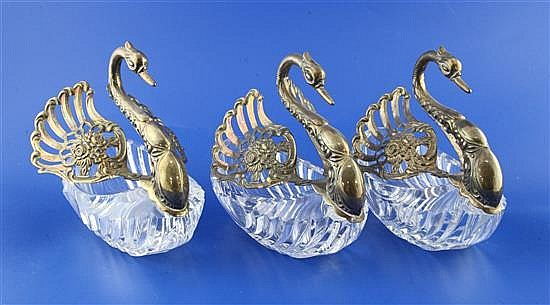 A matched set of three modern repousse silver mounted cut glass sweetmeat dishes modelled as swans, height 6in.