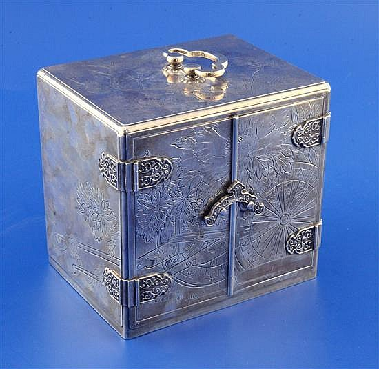 A mid 20th century Japanese sterling silver mounted ebonised two door trinket cabinet, 5in.