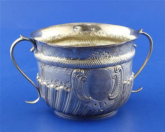 A Victorian repousse demi-spiral fluted silver porringer by Charles Stuart Harris, 7 oz.