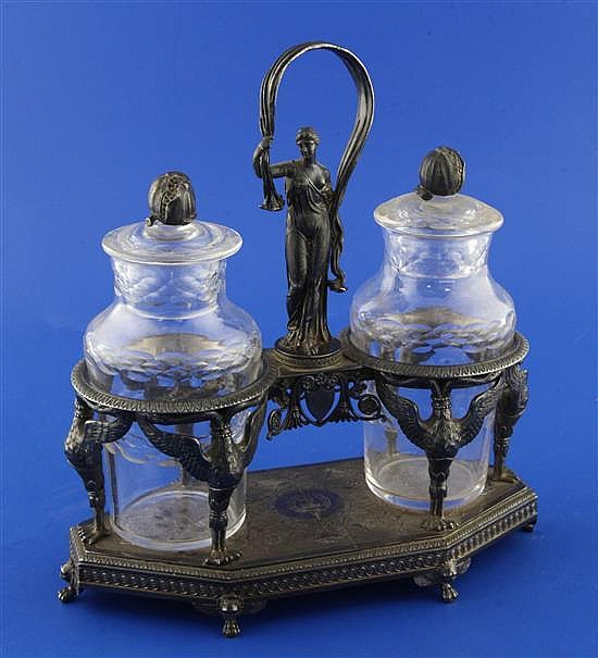 A late 19th/early 20th century French? white metal cruet stand, 8.75in.