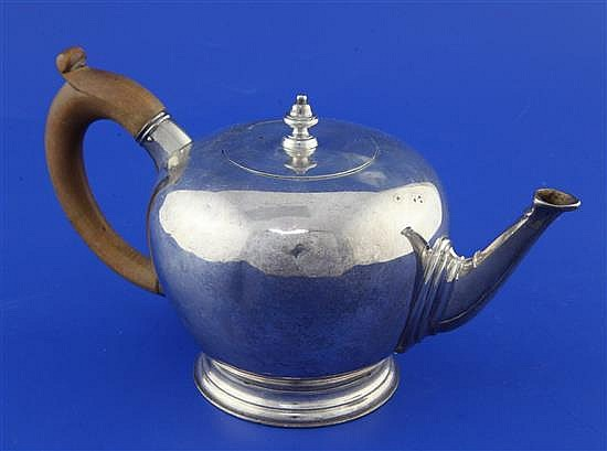 A 1930's 18th century style silver bullet shaped teapot, gross 14.5 oz.