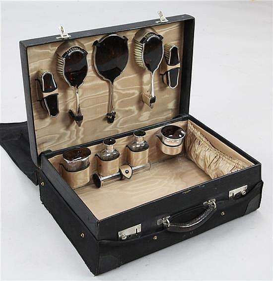 A George V travelling leather toilet case by John Pound & Co Ltd, London.