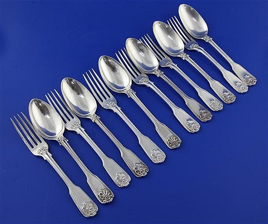 A matched set of six George IV silver double struck fiddle, thread and shell pattern dessert forks and six dessert spoons, 23 oz.