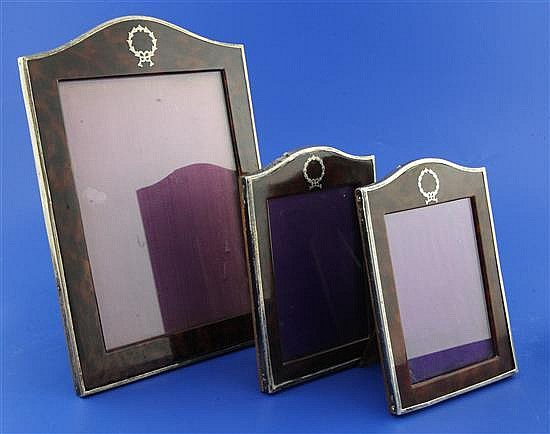 A graduated set of three late 1920's silver and simulated tortoiseshell photograph frames,