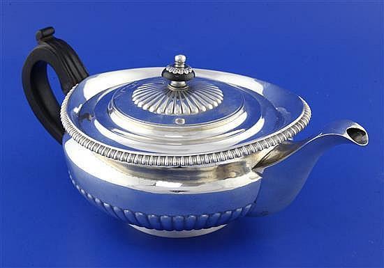 A George III demi-fluted silver teapot, gross 22 oz.