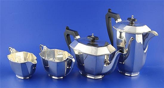 A 1930's four piece silver tea set by Stower & Wragg Ltd, gross 59 oz.