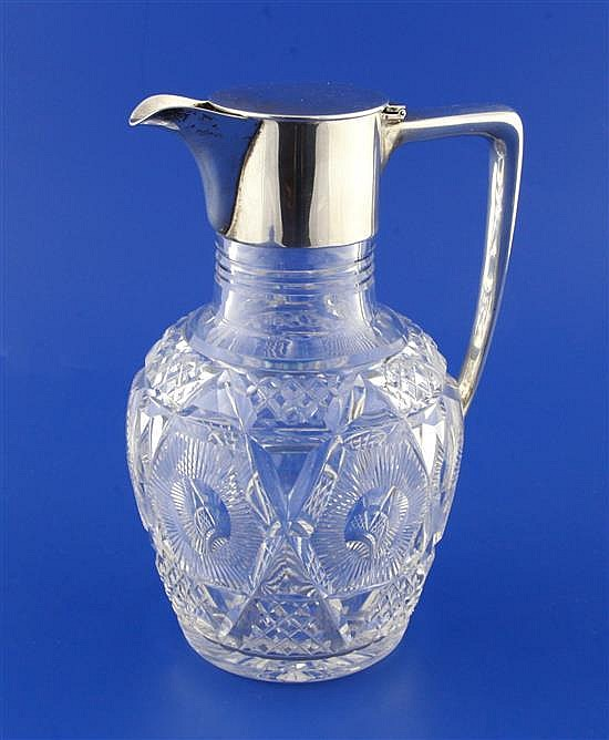 A 1920's silver mounted cut glass claret jug by Mappin & Webb, 7.75in.