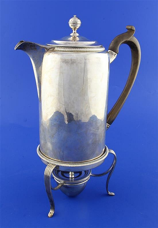 A George III silver hot water pot on stand by Robert Garrard I, gross 25 oz.