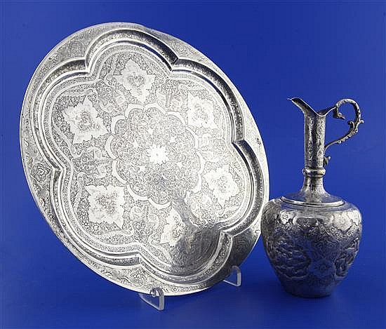 A late 19th/early 20th century Persian silver salver and a white metal ewer.