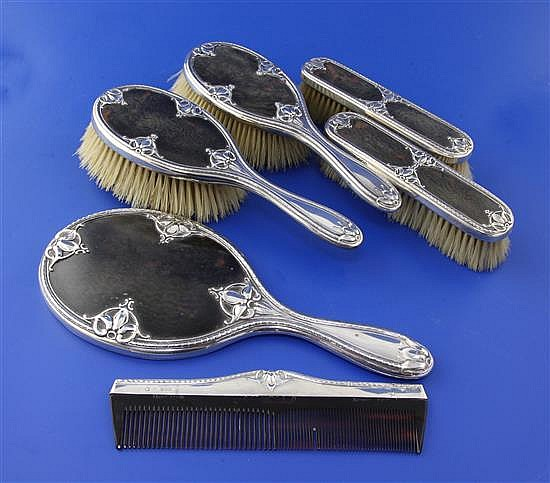 An Edwardian and later silver and tortoiseshell mounted six piece dressing table set,