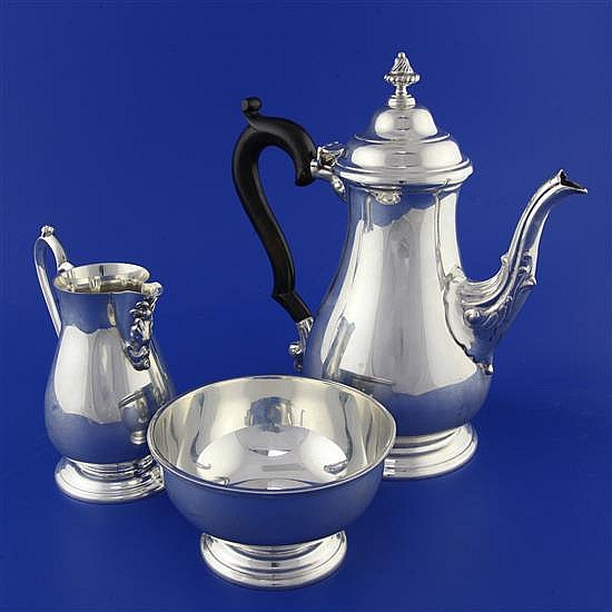An early 20th century 18th century style Indian Colonial silver three piece tea set by Hamilton & Co, Calcutta, gross 40 oz.