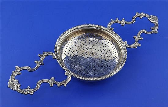 An early George III silver lemon strainer by Samuel Herbert & Co, 4 oz.