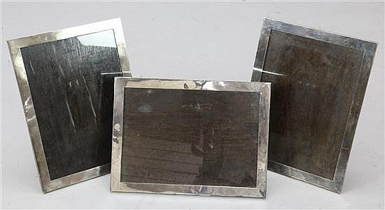 A set of three 1930's large silver mounted rectangular photograph frames by Robert Pringle & Sons, 16in by 11.75in.