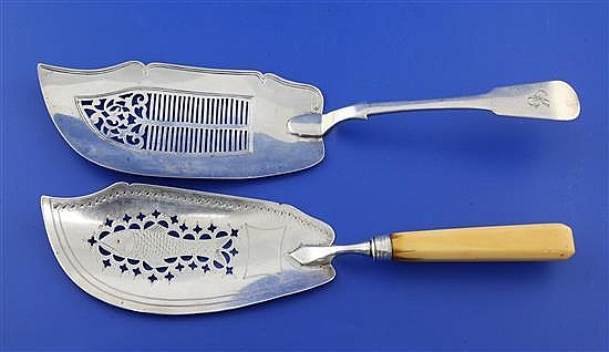 A George III ivory handled silver fish slice and an early Victorian Scottish silver fish slice, gross 7 oz.