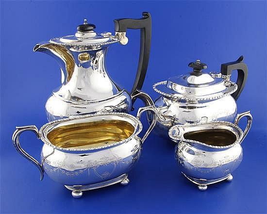 A George V silver matched four piece tea set, gross 69 oz.