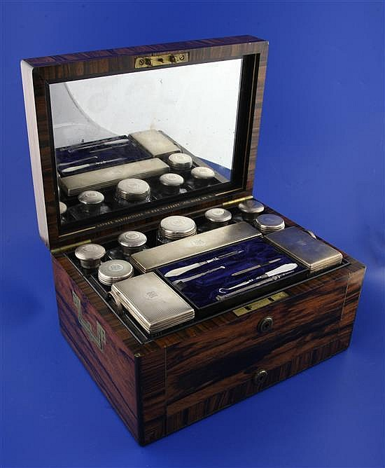 A Victorian brass inlaid rosewood travelling toilet box by Asprey containing ten engine turned silver mounted toilet jars,