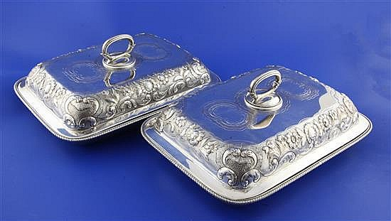 A pair of George III Scottish silver rectangular entree dishes and covers, 80.5 oz.