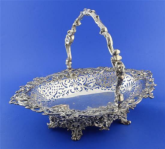 A good Victorian pierced silver oval cake basket by The Barnards, 52.5 oz.