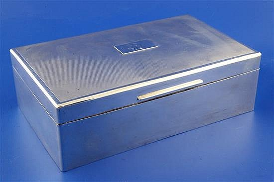 A 1940's engine turned silver mounted rectangular cigar/cigarette box by Mappin & Webb, 10in.