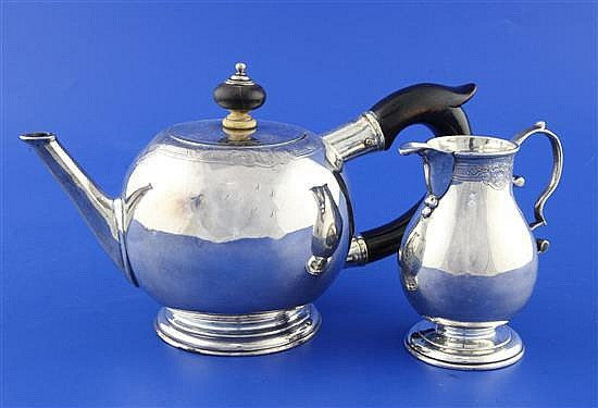 A George I silver bullet shaped teapot and matching cream jug by John Swift, gross 16 ozs.