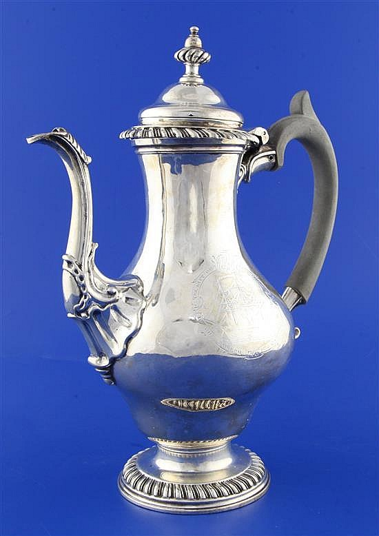 An early George III silver baluster coffee pot By Thomas Whipham & Charles Wright, gross 33.5 oz.