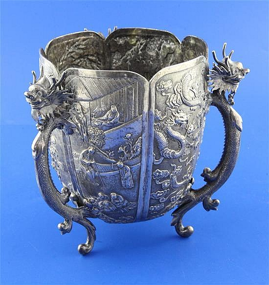 A late 19th/early 20th century Chinese Export silver small jardinere, on three dragon handle supports by Wang Hing, Hong Kong.
