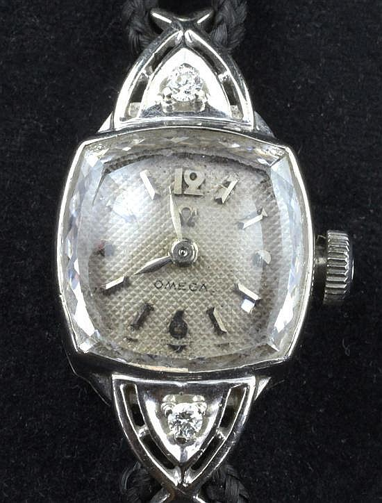 A lady's 1950's 14ct gold and diamond set Omega manual wind cocktail watch,